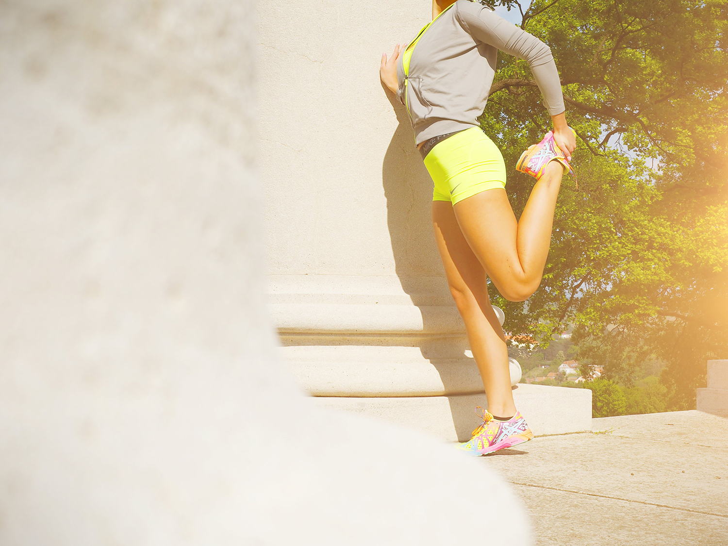 Fit Woman Stretching Legs Outdoors