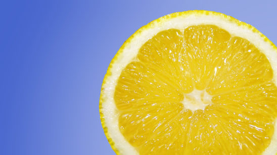 One Slice of Lemon Isolated on Blue Background