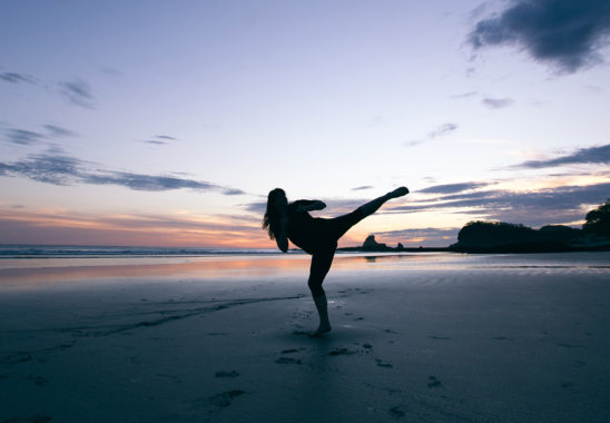 Athletic Woman Training Kickboxing Outdoors