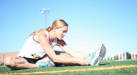Fit Runner Stretching After Running