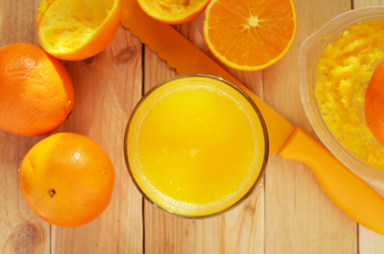 Fruit Juice In a Glass and Oranges