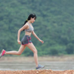 Athletic Woman Running Alone