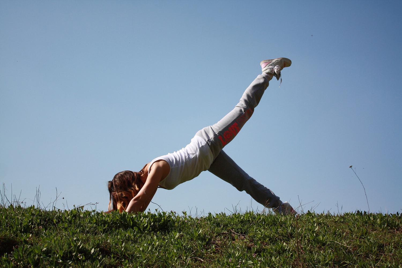 Yogi Doing One Legged Downward-Facing Dog Yoga Pose Outdoors