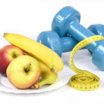 Fitness and Weight Loss Concept. Apples, Dumbbells,Tape Measure, Bananas