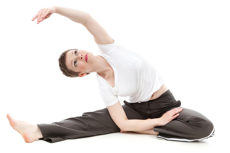 Flexible Woman Doing Seated Yoga Pose