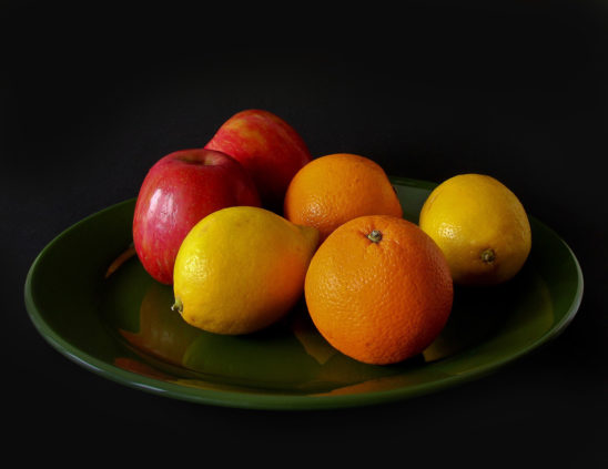 Fresh Fruits on A Plate Oranges, Lemons and Apples