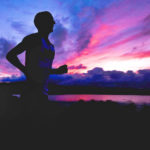 Silhouette of Man Running In The Evening