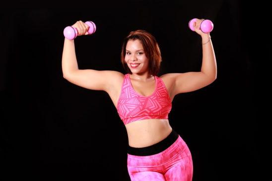 Sporty Woman Lifting Pink Weights