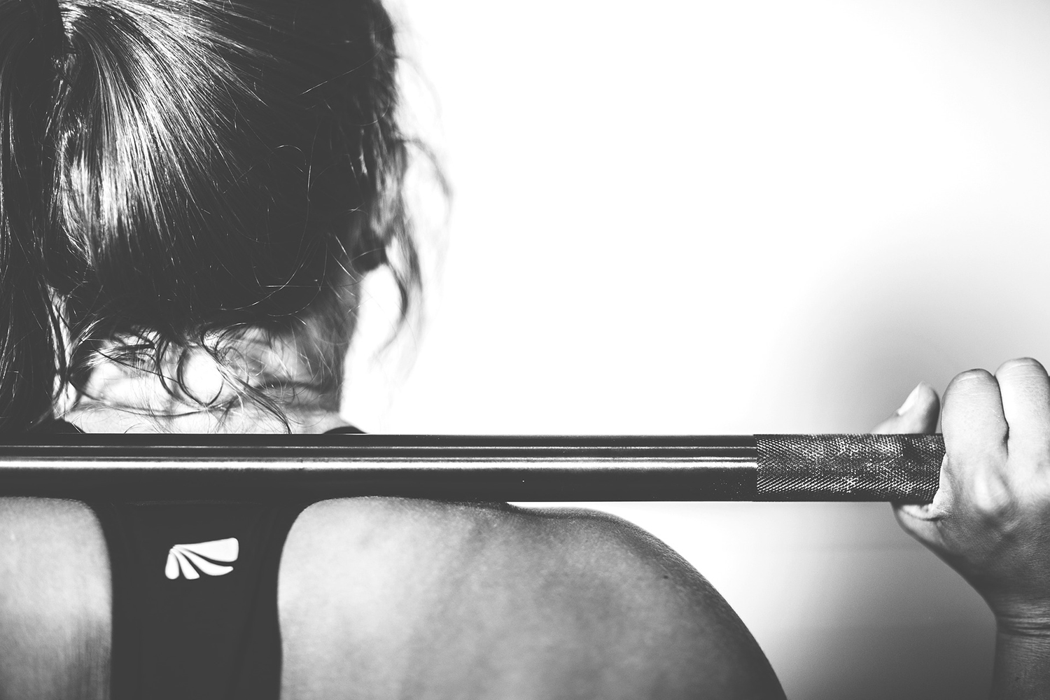 Crossfit Woman Doing Barbell Squats