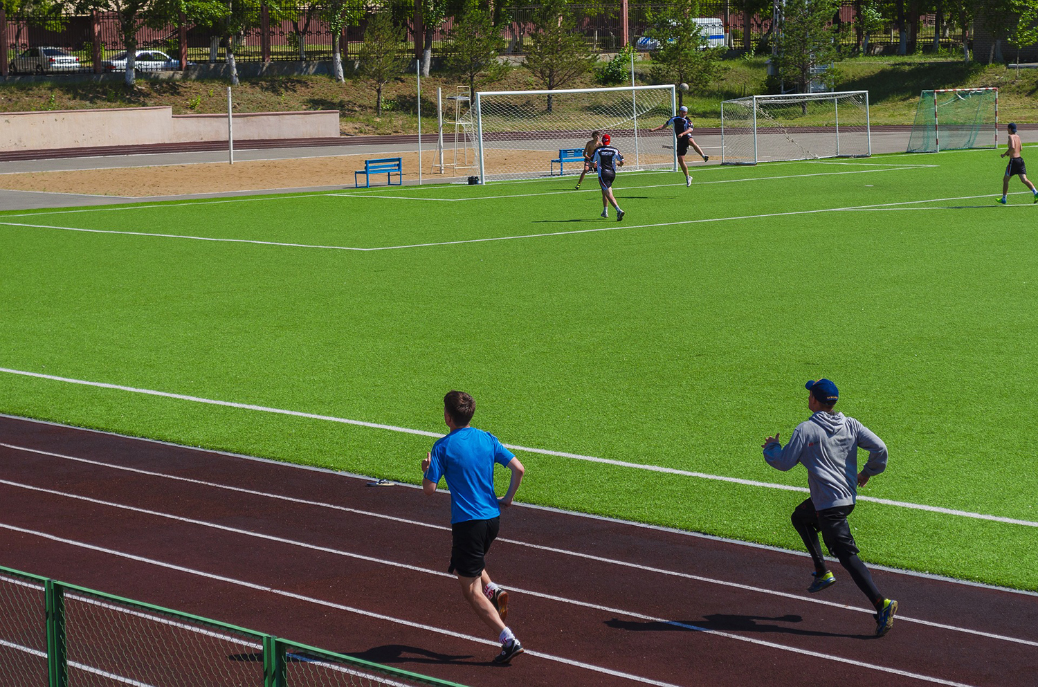 Male Athletes Running On The Track