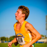 Sweaty and Tried Boy Running in A Marathon