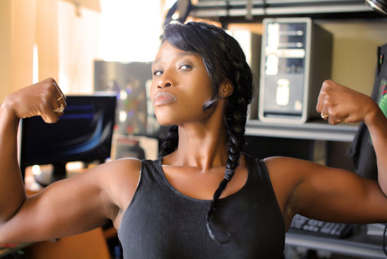 Strong Woman Flexing Biceps Muscles