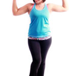 Smiling Woman Flexes Biceps Muscles