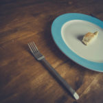 Dieting Concept Plate With A Piece of Bread and A Folk