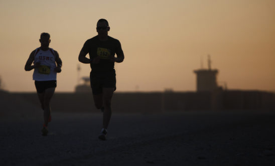 Two Men Running In The Evening