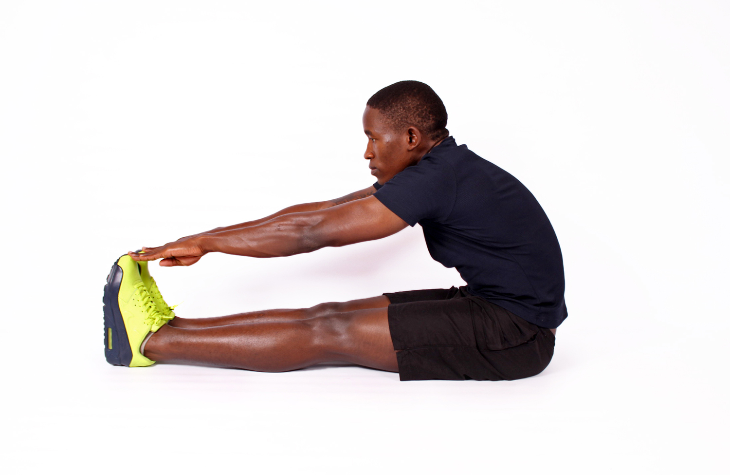 African fitness man stretching legs touch toes