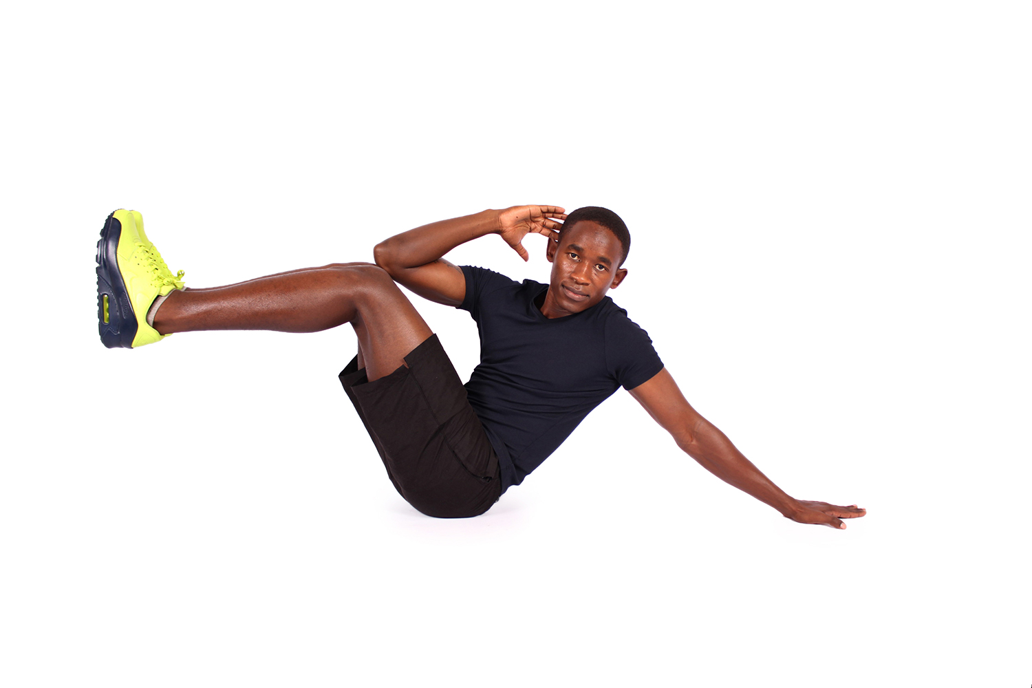 African male doing sit up crunches with arm on the floor