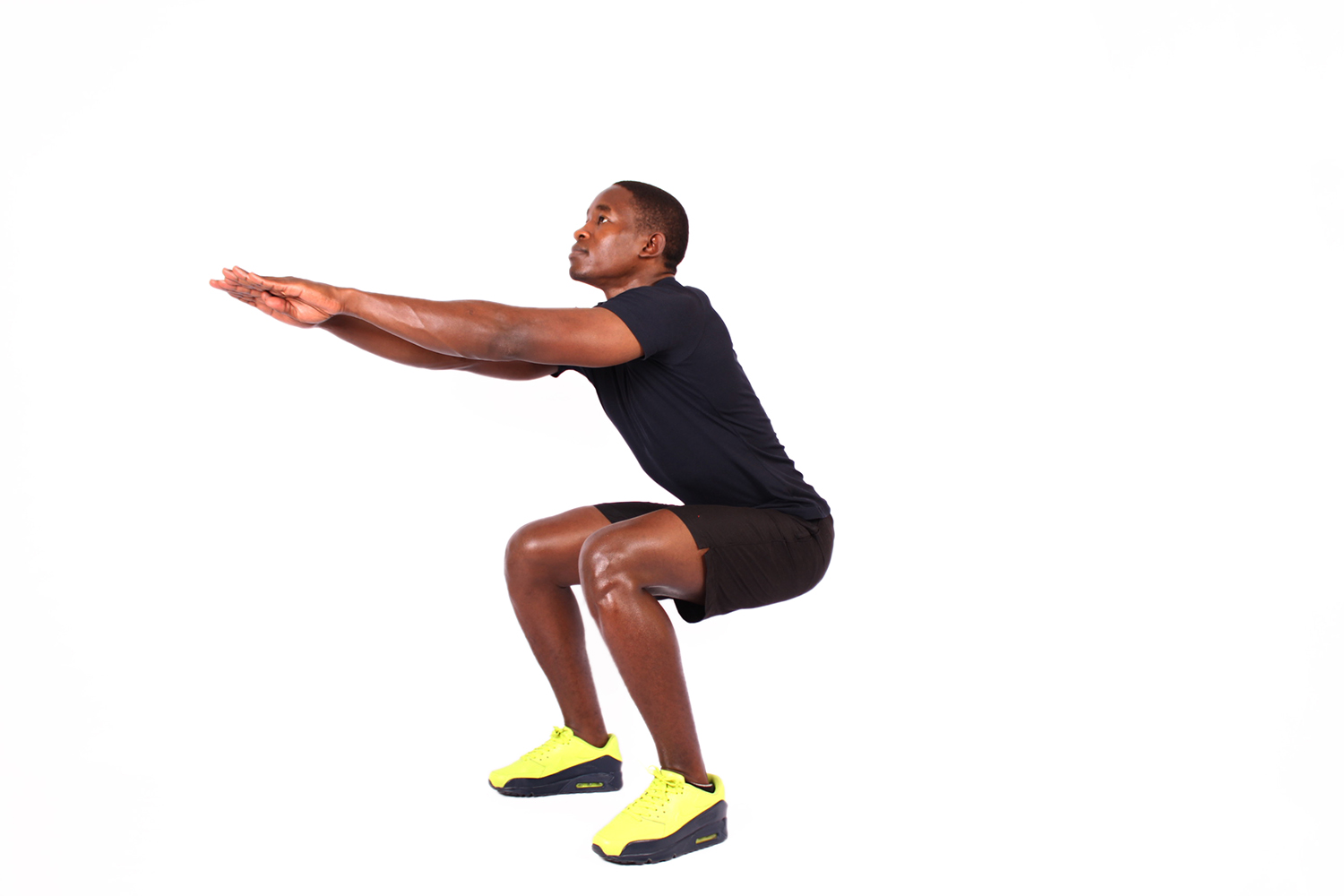 African man doing air squats lower body exercise
