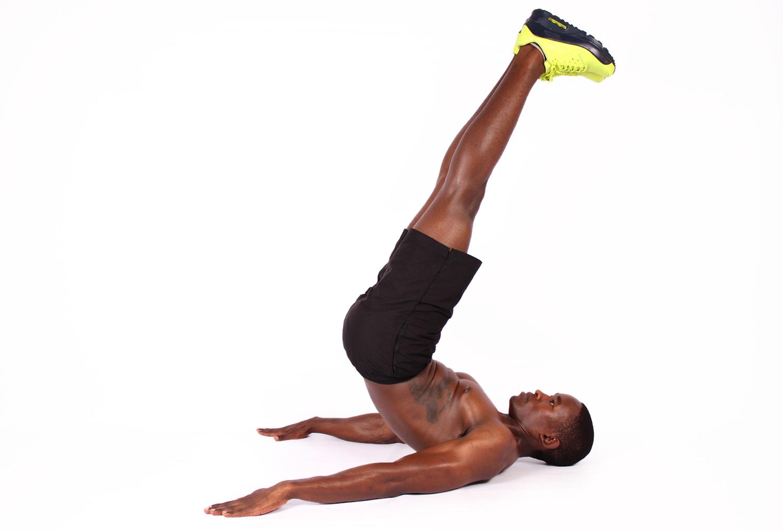 Shirtless Man Doing Lying Leg thrusts Ab Exercise