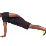 African man doing one arm push ups on white background