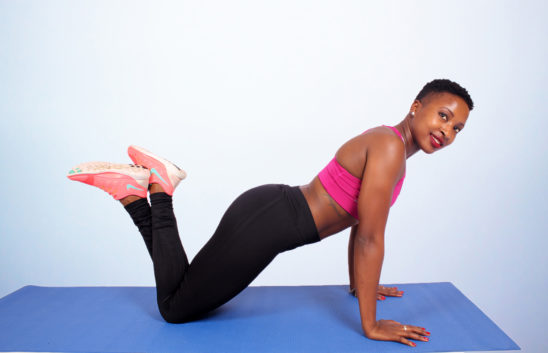 Smiling Woman Doing Knee Push Ups