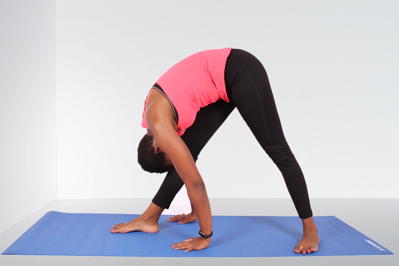 African woman doing yoga in studio