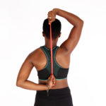 African Woman Stretching Hands and Shoulders Using Resistance Bands