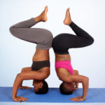 Two Yoga Partners Doing Headstand Pose