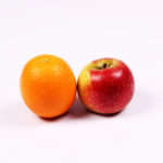 Apple and orange on white background