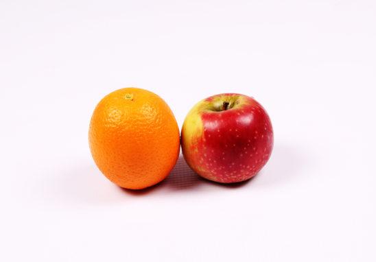 Apple and orange on white background