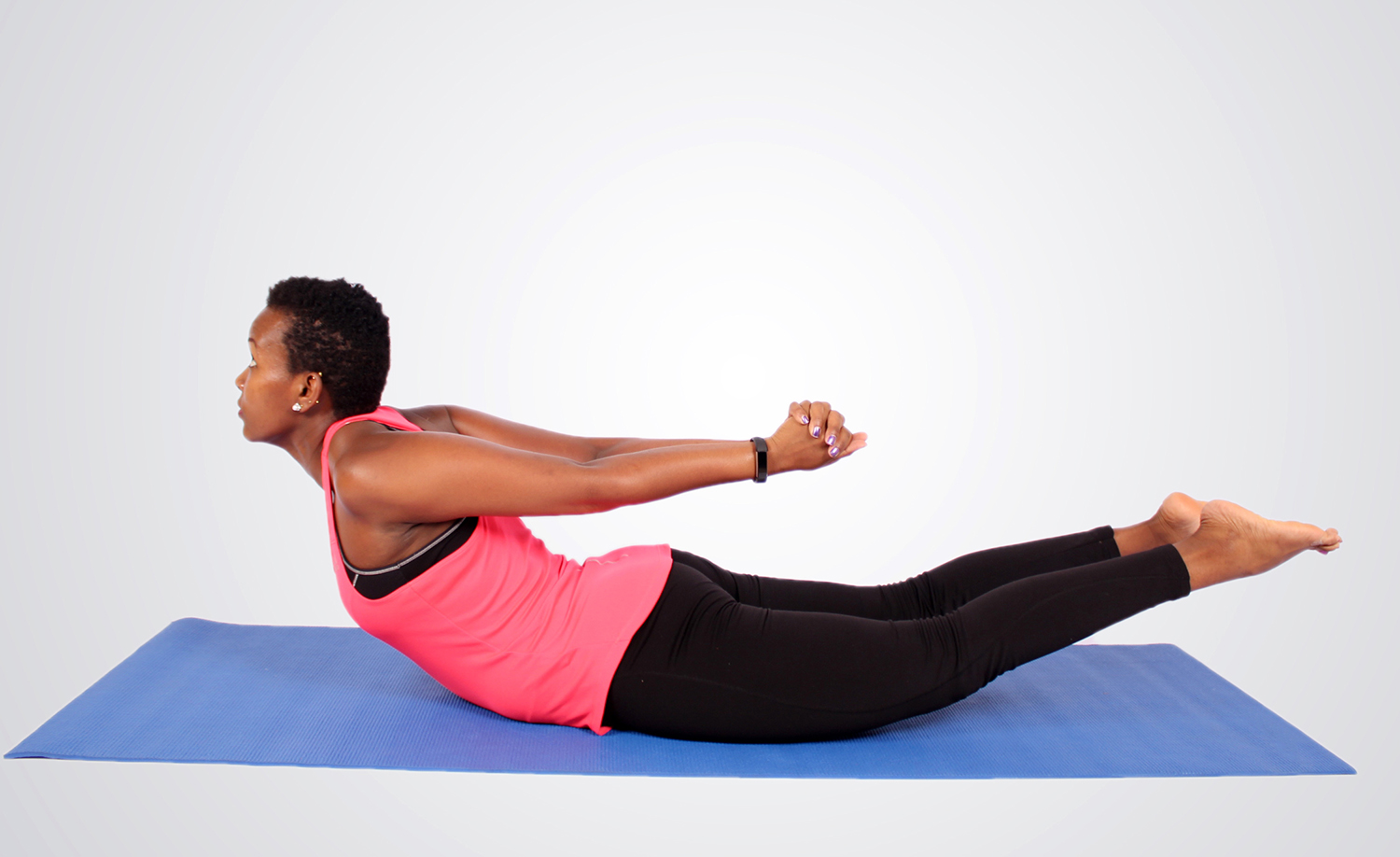 Athletic Woman Doing Locust. Yoga Pose Lying Face Down
