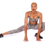 Athletic Woman Stretching on isolated white background