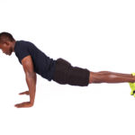 Athletic african man not doing push ups properly sinking hips