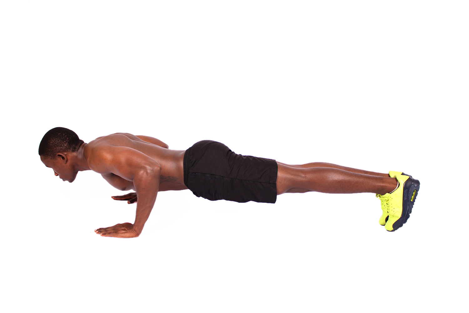 Shirtless Muscular Man Doing Push Ups on White Background