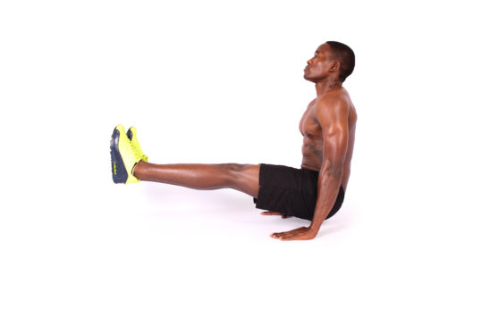 Athletic man doing L sit ab exercise