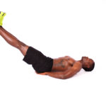 Shirtless Muscular Man Doing Leg Raises Ab Exercise
