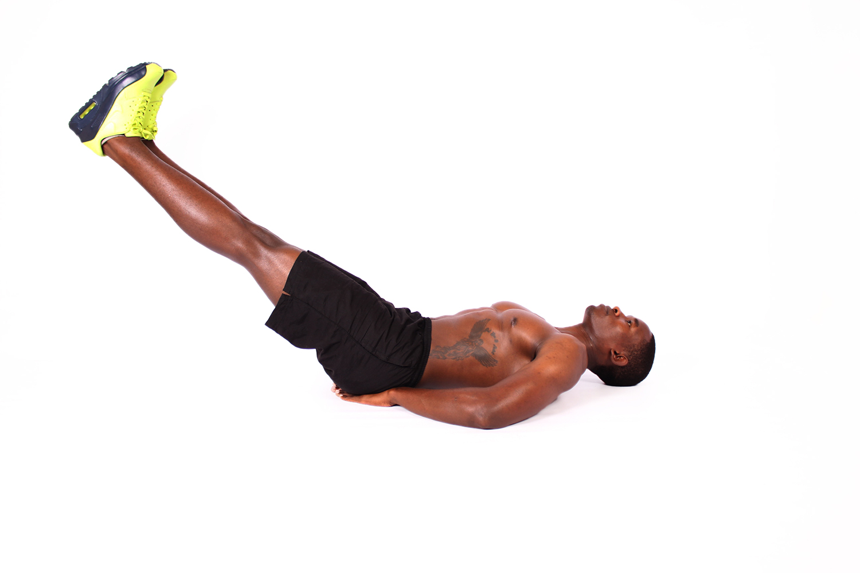 Shirtless Muscular Man Doing Leg Raises Ab Exercise
