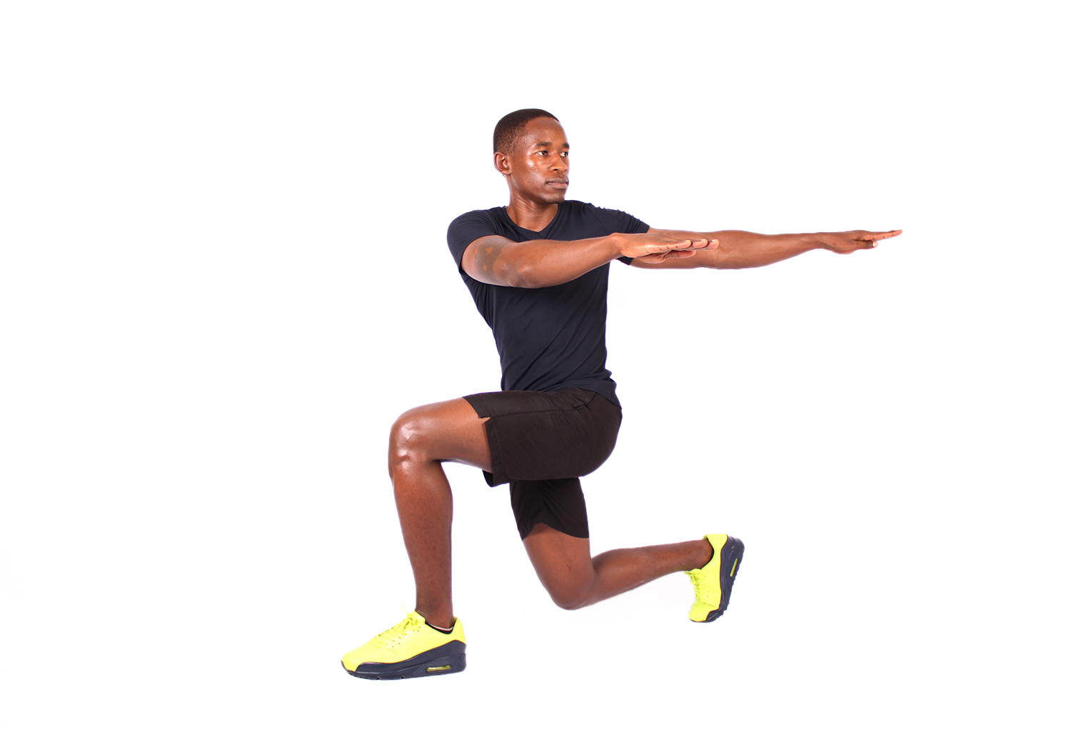 Athletic man doing lunge with twist