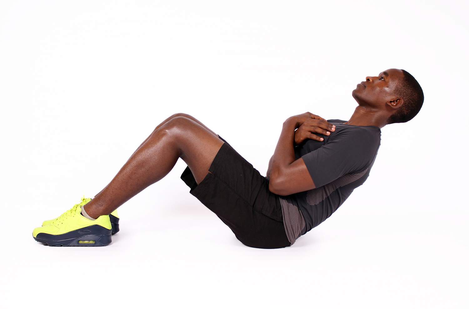Athletic man doing sit up crunches exercise