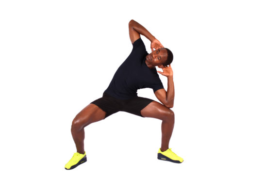 Athletic man doing squats with side bend