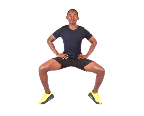 Athletic Man Doing Tip Toe Sumo Squats