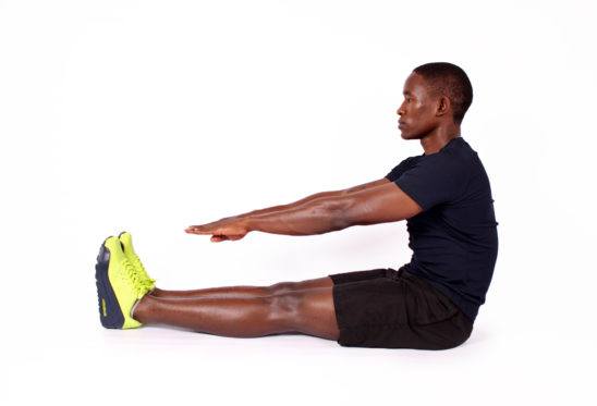 Athletic man with stiff hamstrings touches toes