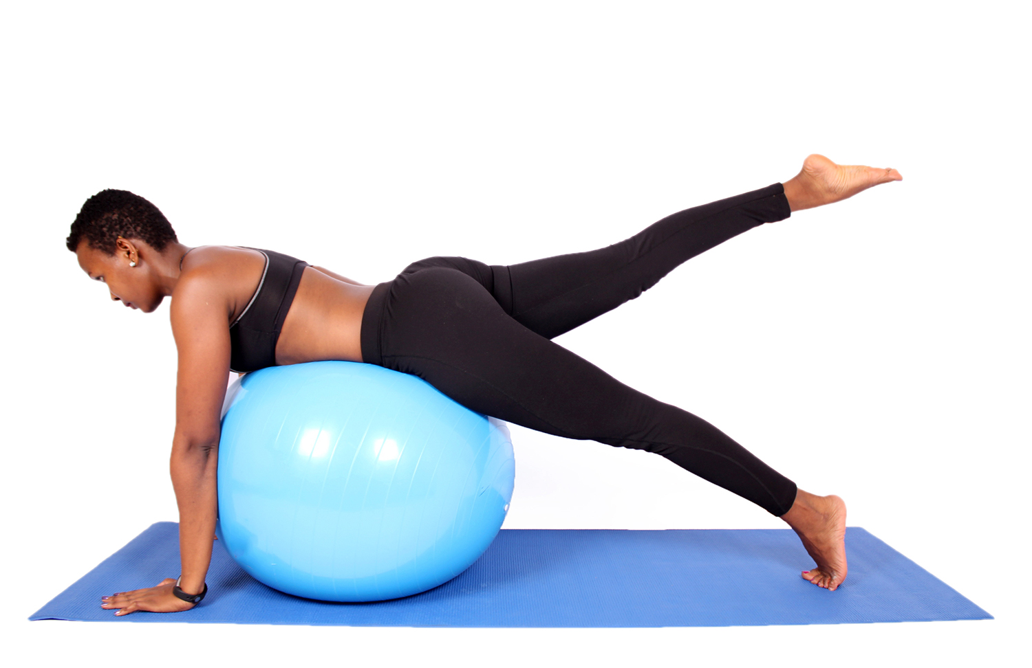 Athletic Woman Doing Butt and Lower Back Exercise Lying on Swiss Ball