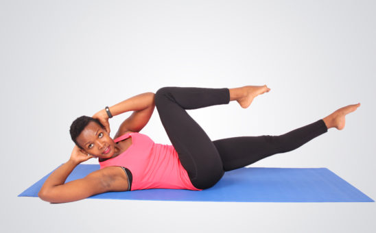 Athletic woman doing bicycles ab exercise