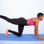 Athletic woman doing donkey kicks exercise