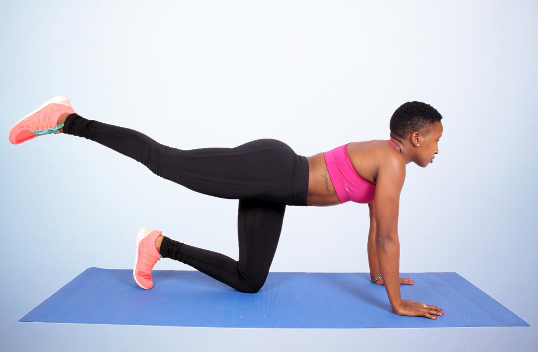 Athletic woman doing donkey kicks exercise