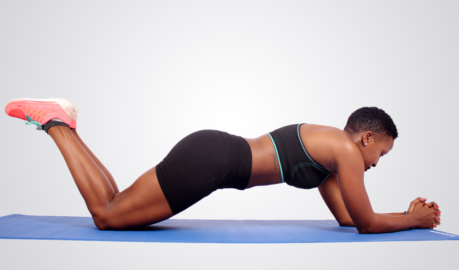 Fitness Woman Doing Knee Plank Variation