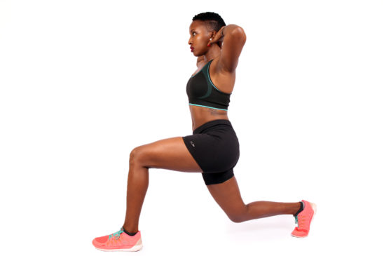 Athletic Woman Doing Lunges With Hands Behind Head