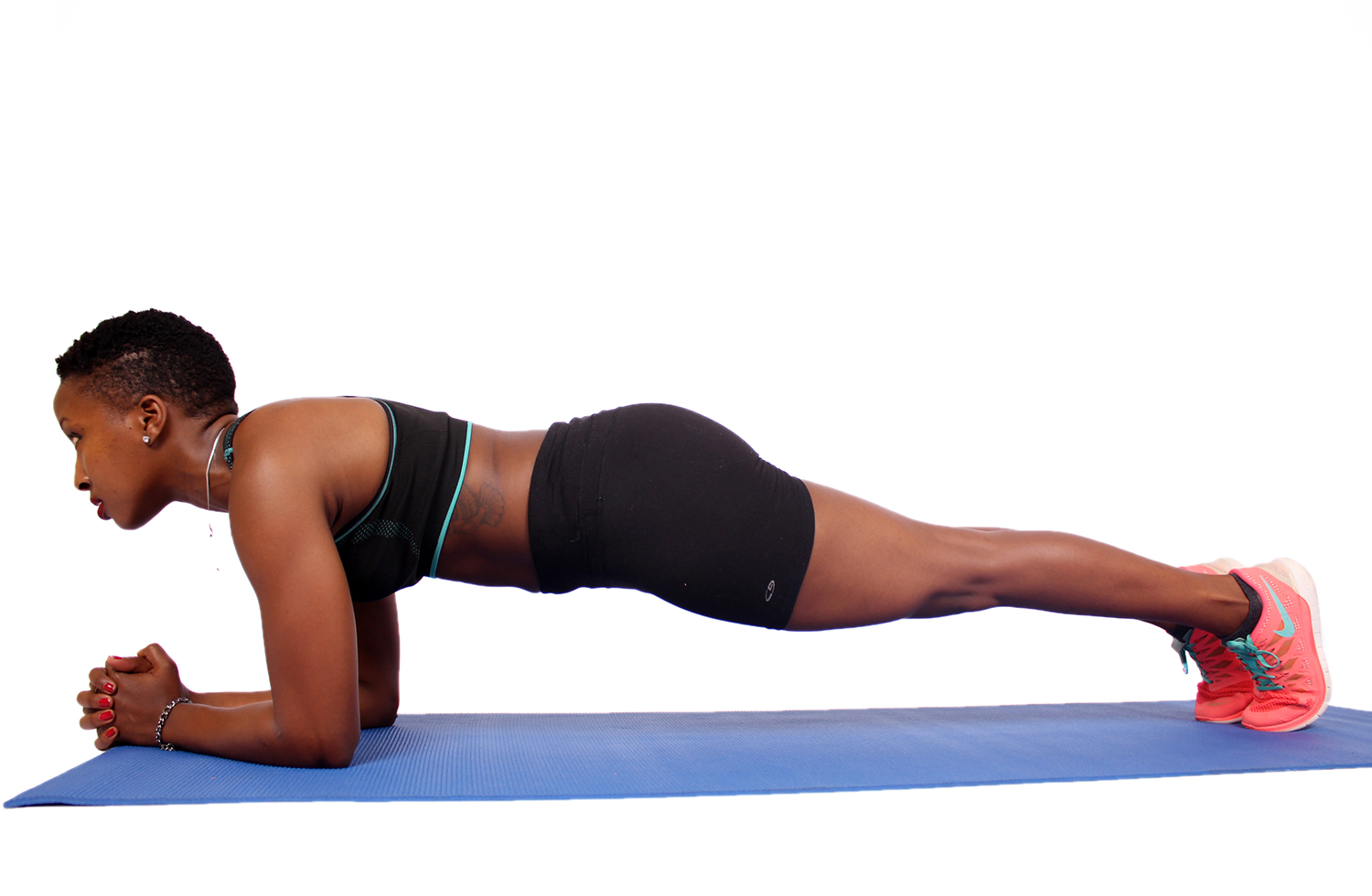 Athletic woman doing plank exercise