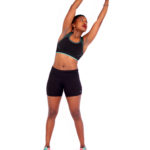 Athletic woman doing side stretch for stomach and obliques